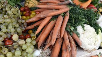 Fruits and vegetables judged ugly by mass market retailers, are pictured during 'Anti-gaspi, pour le climat aussi' (Fighting waste, also for climate change) an operation organized by the Paris City Hall in partnership with the French Agriculture ministry, as part of a national day of action against food wastage, on October 16, 2016 on the Place de l'Hotel de Ville in Paris. AFP PHOTO / MIGUEL MEDINA        (Photo credit should read MIGUEL MEDINA/AFP/Getty Images)