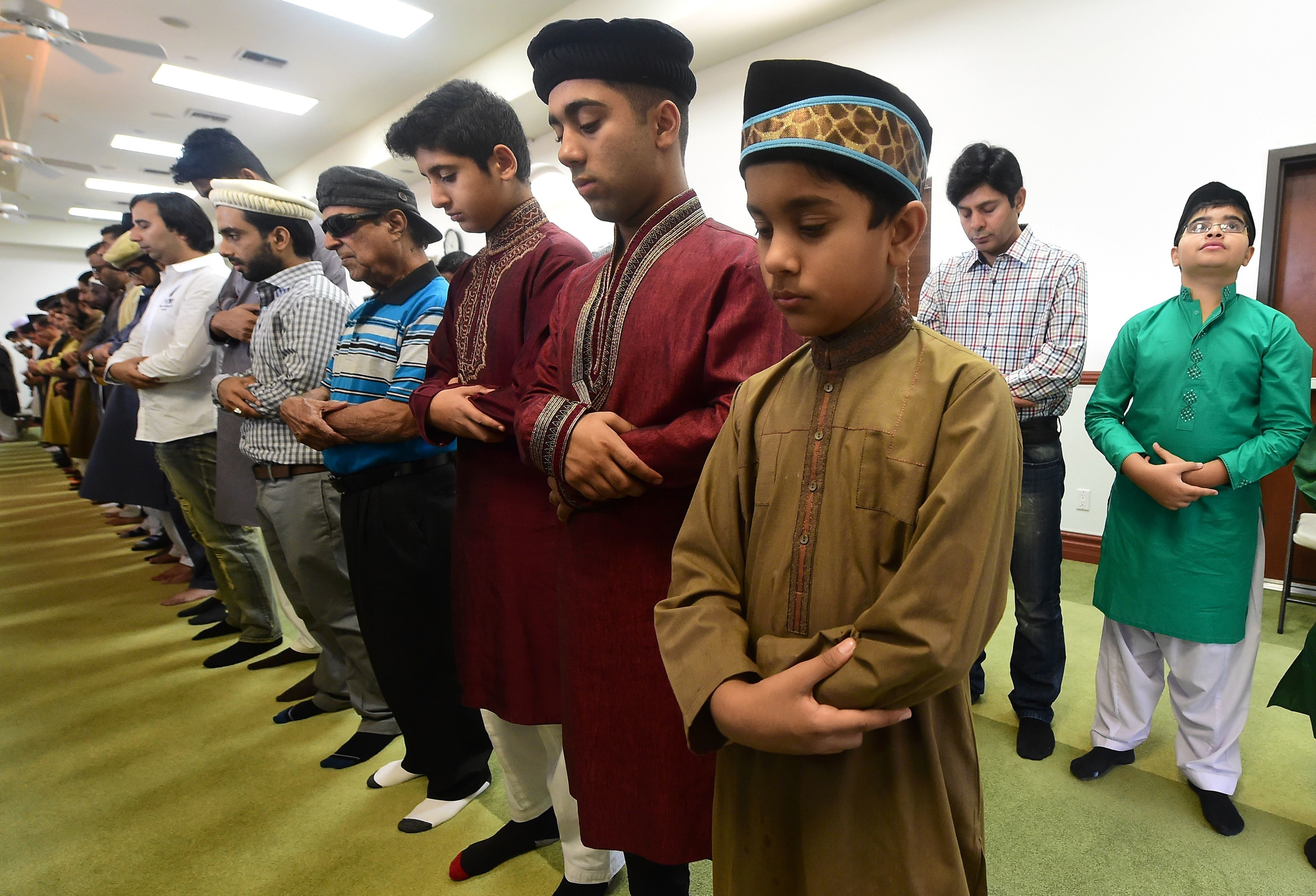 Muslims pray while celebrating Eid al-Fitr, marking the end of fasting during the month-long Ramadan, at the Baitul Hameed Mo