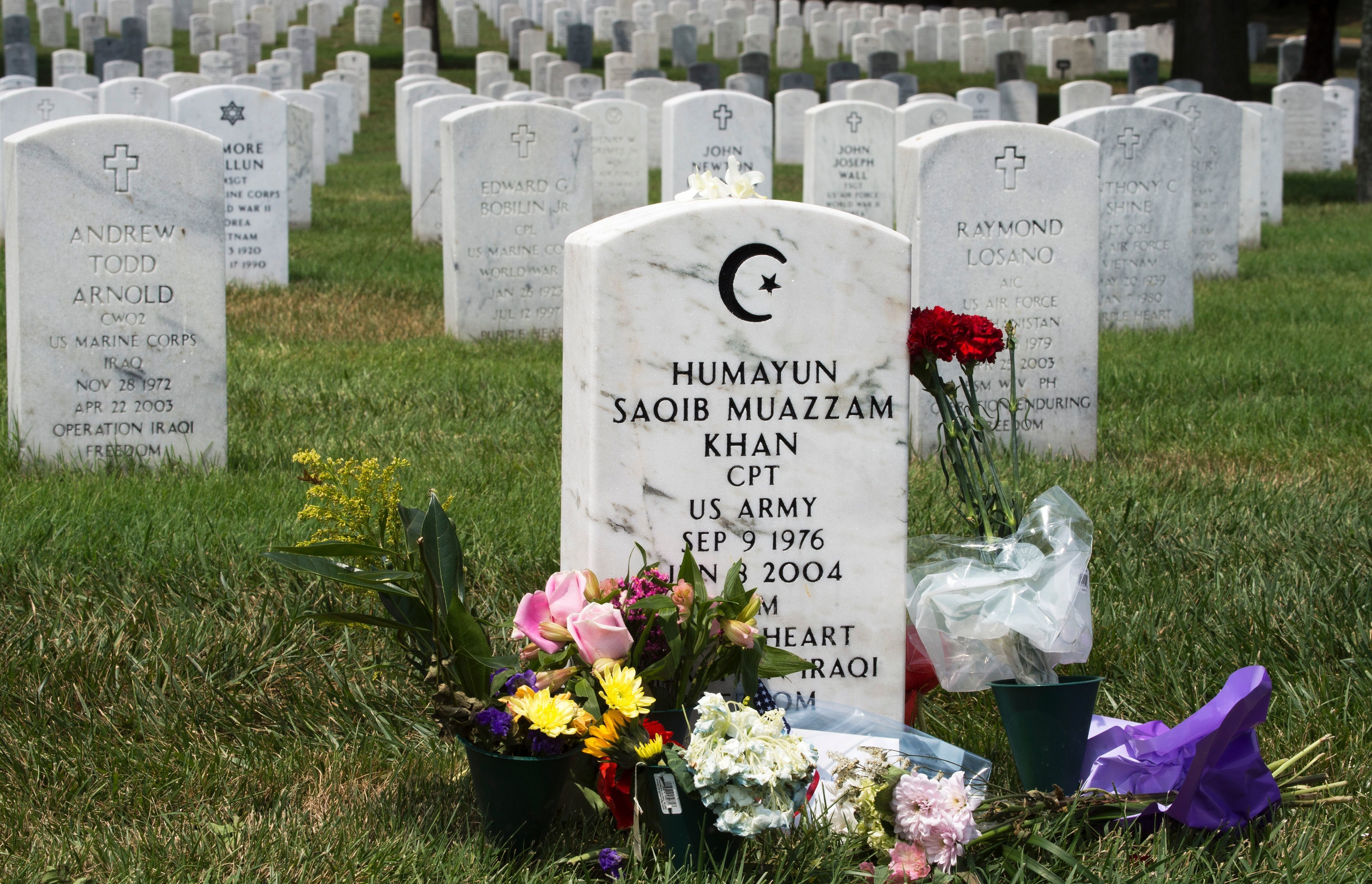 The grave marker for US Army Captain Humayun Saqib Muazzam Khan,who was killed in Iraq in 2004 in a roadside explosion, is seen August 1, 2016, in Section 60 of Arlington National Cemetery in Arlington, Virginia. The father of a slain Muslim American soldier assailed Donald Trump as a 'black soul' July 31 in an impassioned exchange with the Republican presidential candidate over the qualities required in a US leader. Khizr Khan electrified the Democratic convention last week with a tribute to his fallen son that ended with a steely rebuke that Trump had 'sacrificed nothing' for his country.  / AFP / Paul J. Richards        (Photo credit should read PAUL J. RICHARDS/AFP/Getty Images)