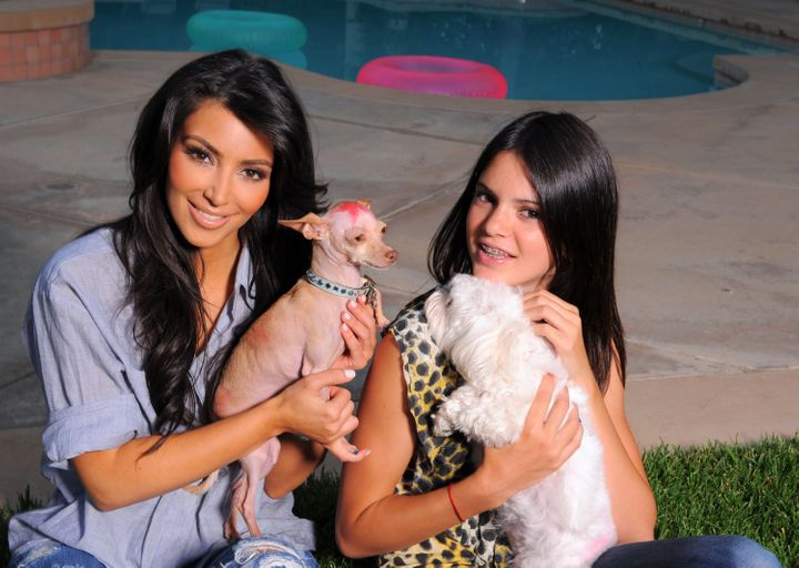 Kim Kardashian and dog Dolce pose with sister Kendall Jenner and dog Bella during a photo shoot on Jul. 7, 2009, in Los Angel