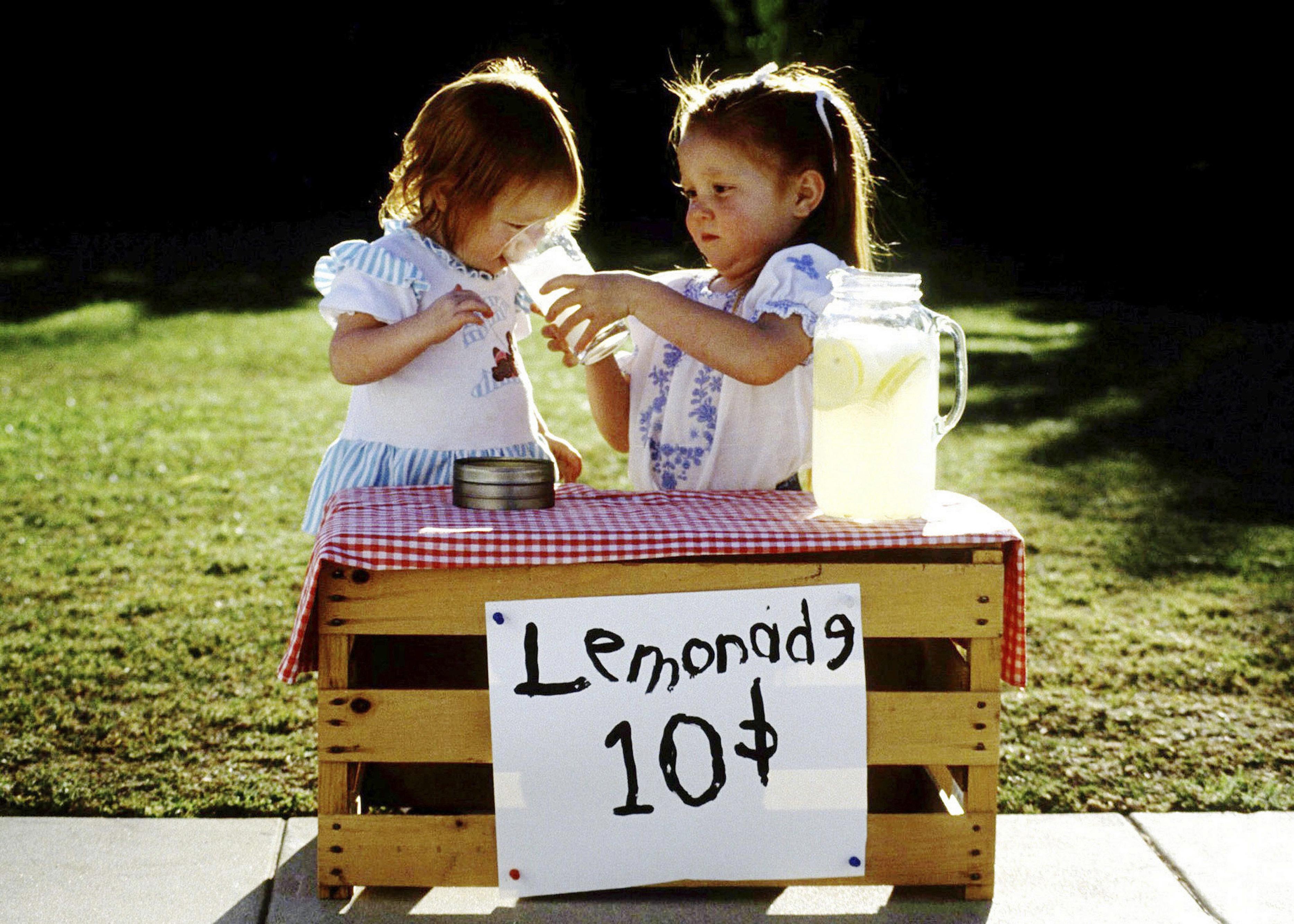 Two girls at running lemonade stand