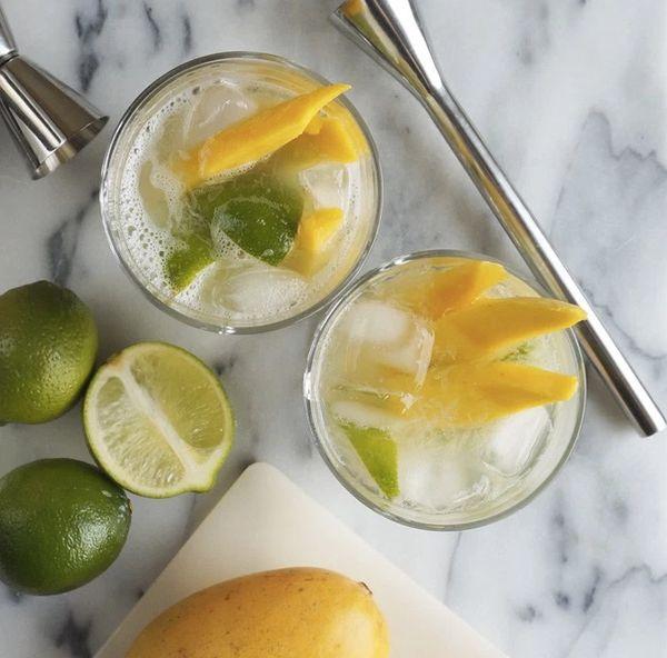 """<strong>Get the <a href=""""http://www.edible-woman.com/mango-caipirinhas/"""" target=""""_blank"""">Mango Caipirinhas recipe</a>fr"""