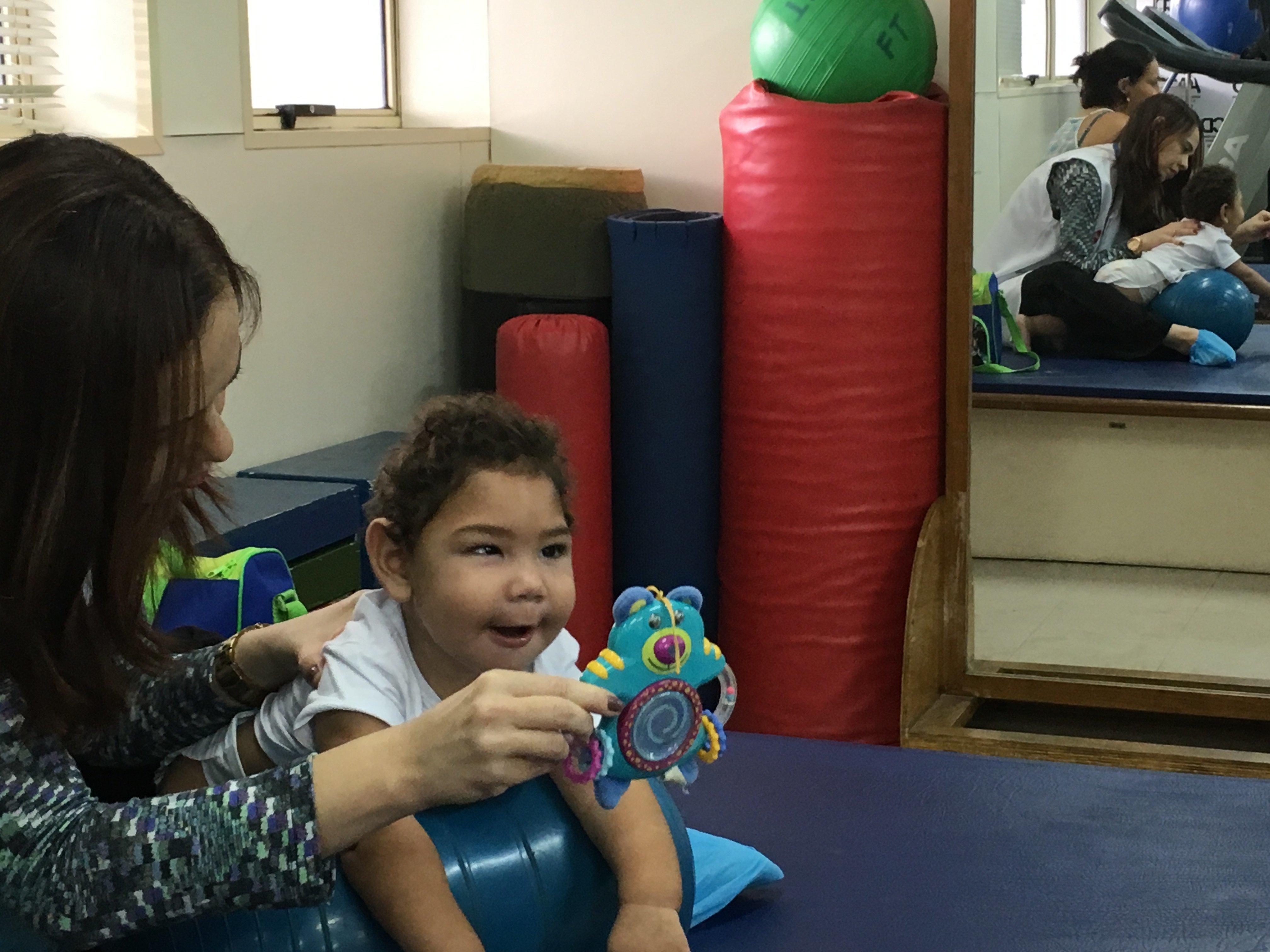 Dr. Ana Patrícia treats José Bernardo, who was born with microcephaly.