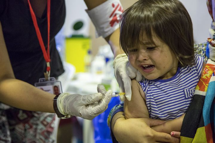 Doctors Without Borders gives a vaccine to a refugee child.