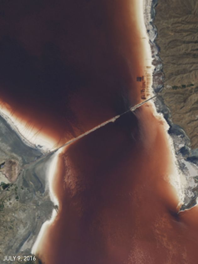 Close-Up. The waters surrounding the Lake Urmia bridge shifted from green on April 20 to red by July