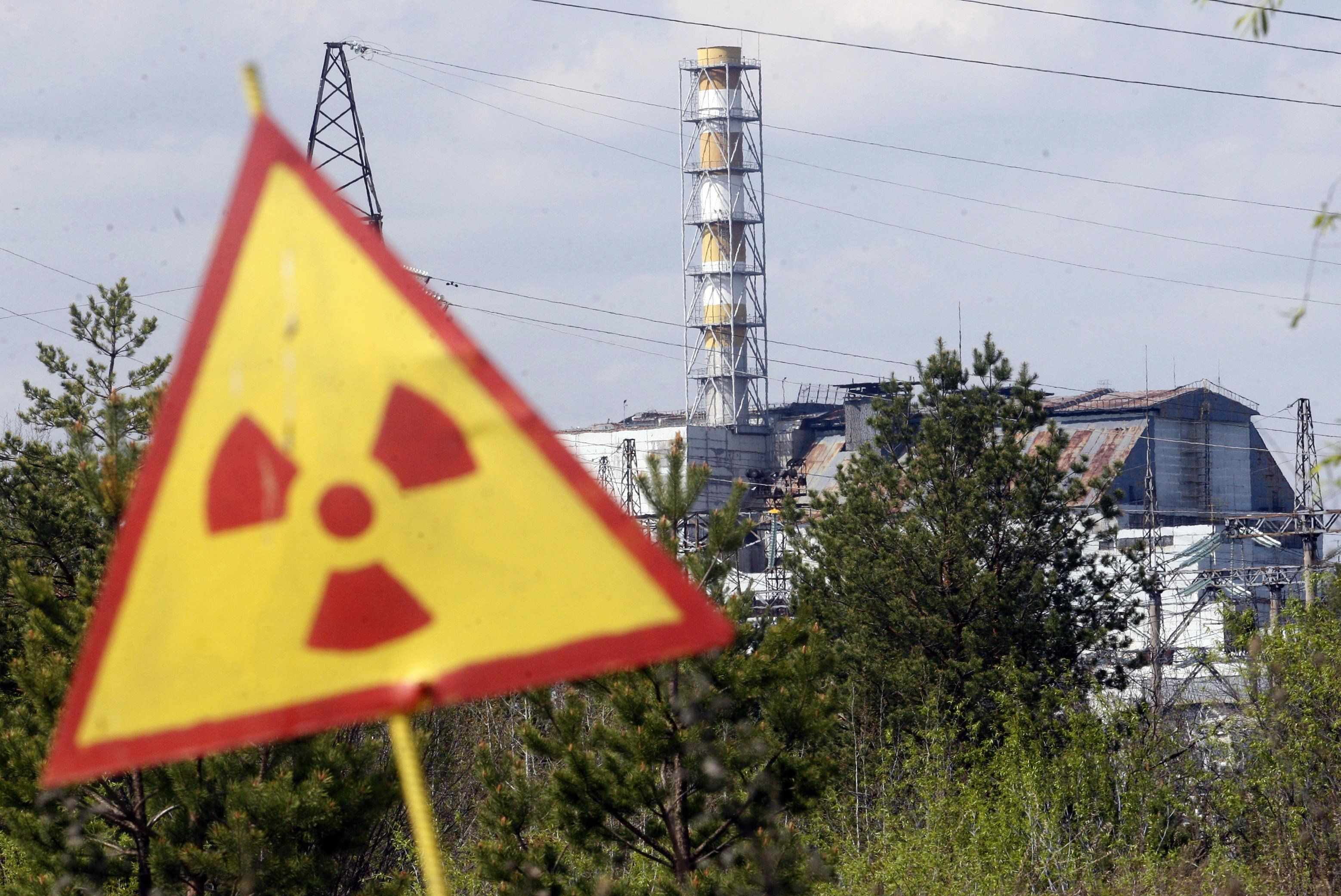 A radiation sign is seen in front of the Chernobyl Nuclear Power plant after firefighters have nearly extinguished a forest fire near Chernobyl plant, which came within about 20 kilometres (12 miles) of Chernobyl after breaking out on April 28, 2015, but officials said it posed no danger to the plant and radiation levels in the zone remained unchanged. AFP PHOTO / ANATOLII STEPANOV        (Photo credit should read ANATOLII STEPANOV/AFP/Getty Images)
