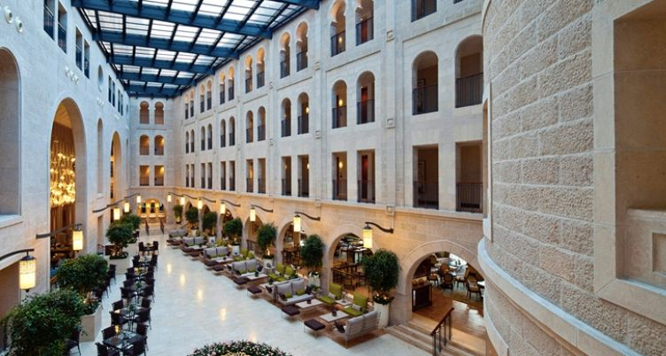 The lobby atrium of the Waldorf Astoria Jerusalem