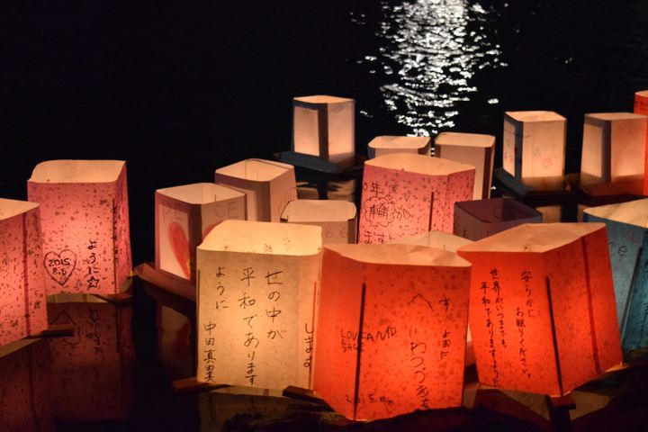 People from all over the world write messages of peace on paper lanters to commemorate the anniversary of the bombing.