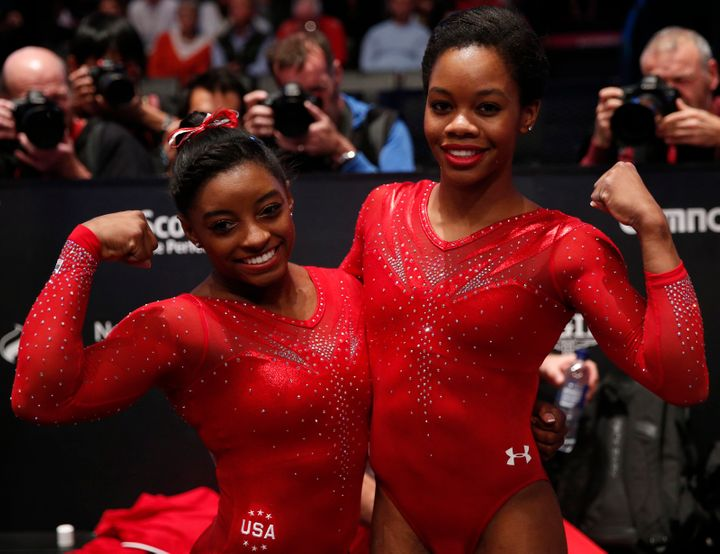 Gold medalist Simone Biles, left, celebrates with silver medalist Gabrielle Douglas after the women's all-round final at