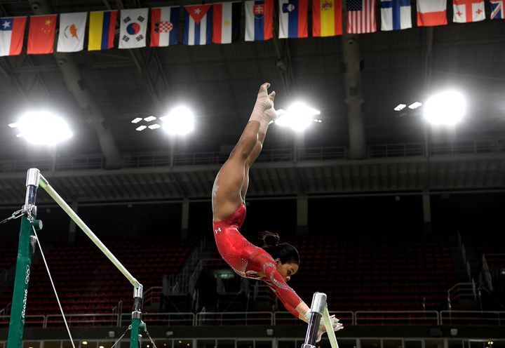 Gabby Douglas practices on the uneven bars during a training session on Thursday in Rio de Janeiro.