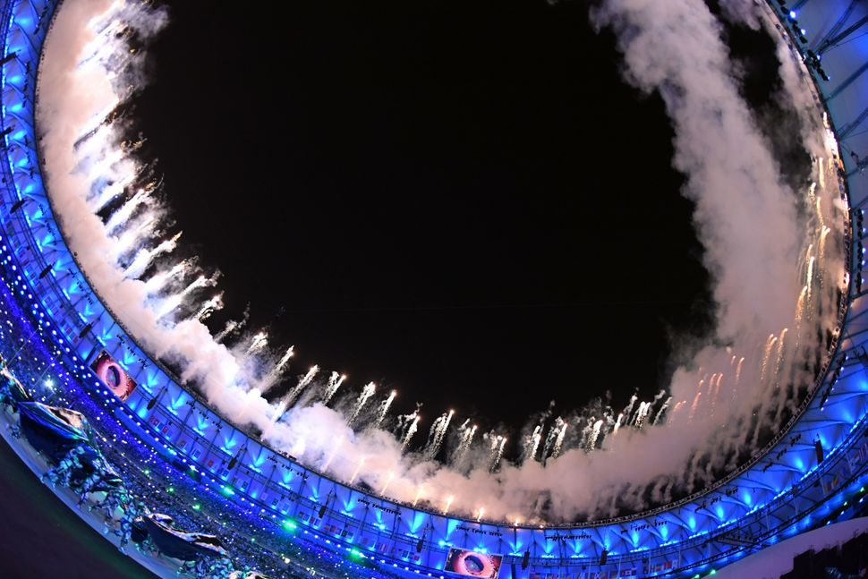 Fireworks go off around the stadium during the opening ceremony.