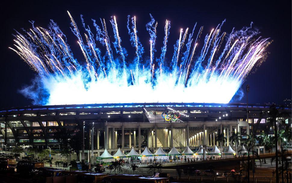 Fireworks go off over the Maracana Stadium.