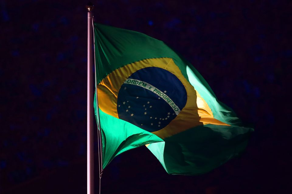 The Brazilian flag is seen during the Opening Ceremony.
