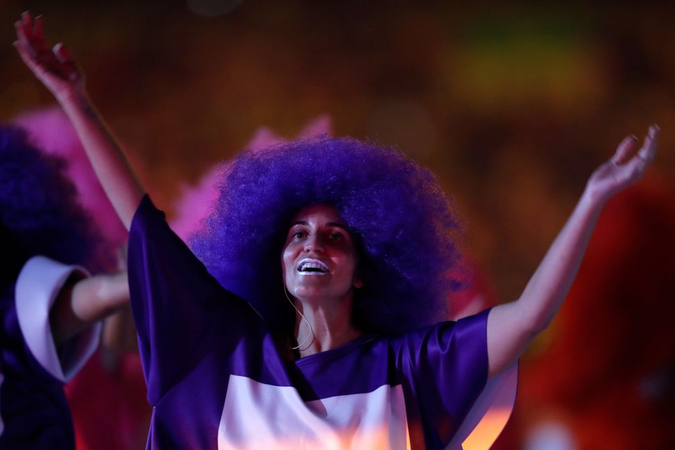 A dancer performs during the Opening Ceremony of the Rio 2016 Olympic Games at Maracana Stadium.