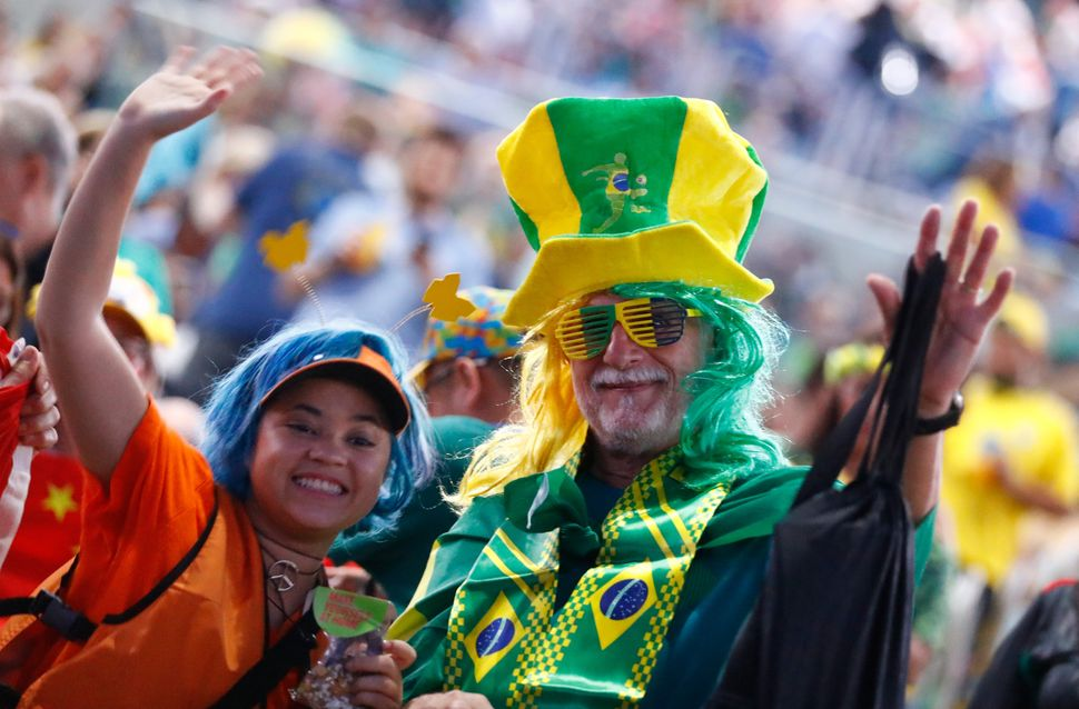 Chinese and Brazilian fans before the opening ceremony.