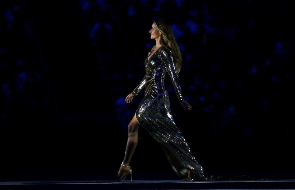 Brazilian top model Gisele Bundchen takes part in the opening ceremony.