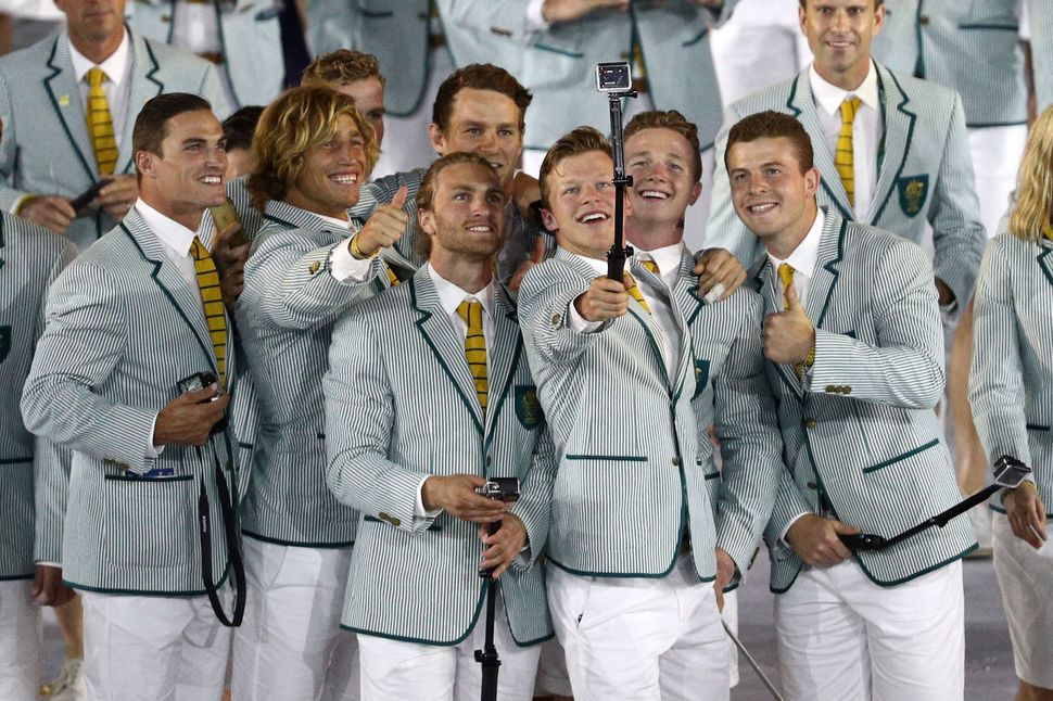 Members of the Australia Olympic Team talk photos during the Opening Ceremony of the Rio 2016 Olympic Games.