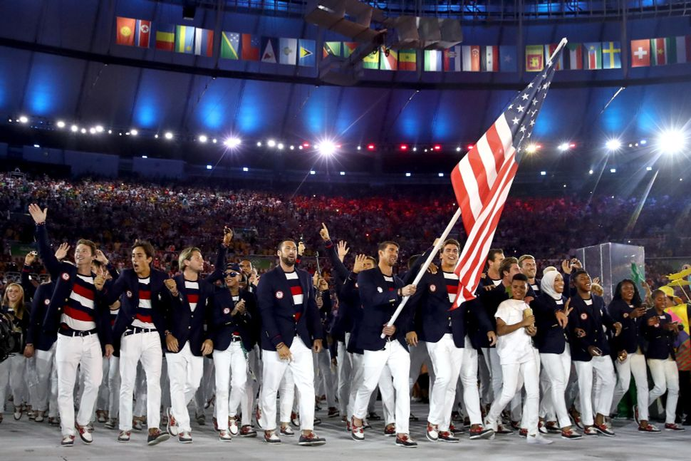 Michael Phelps of the United States carries the flag during the Opening Ceremony of the Rio 2016 Olympic Games.
