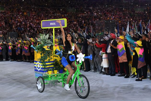 A woman on a bicycle leads the Brazil delegation during the opening ceremony of the Rio 2016 Olympic...