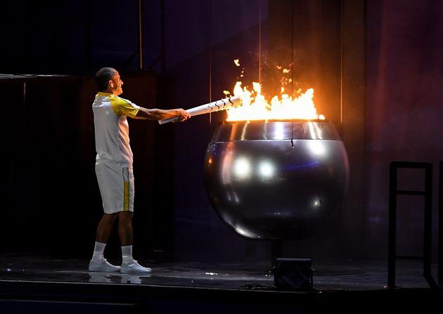 Final torch bearer Vanderlei Cordeiro de Lima lights the Olympic