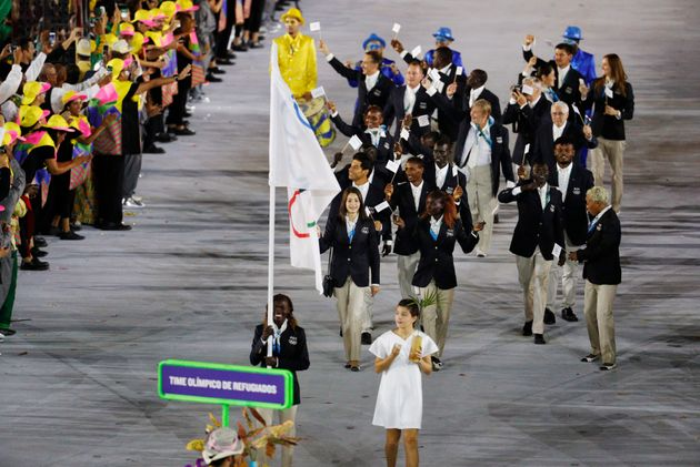 Flagbearer Rose Nathike Lokonyen (ROT) of the Refugee Olympic Athletes leads her contingent during the...