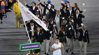 Refugee Olympic Team's Rose Nathike Lokonyen leads her delegation during the opening ceremony of the Rio 2016 Olympic Games at the Maracana stadium in Rio de Janeiro on August 5, 2016. / AFP / PEDRO UGARTE        (Photo credit should read PEDRO UGARTE/AFP/Getty Images)