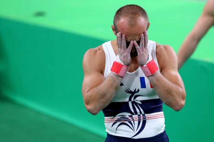 France's Danny Pinheiro Rodrigues reacts after teammate Samir Ait Said brokehis leg while competing on the vault on Day