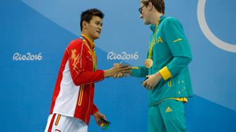 RIO DE JANEIRO, BRAZIL - AUGUST 06:  (L-R) Silver medalist Yang Sun of China and gold medal medalist Mack Horton of Australia pose during the medal ceremony for the Final of the Men's 400m Freestyle on Day 1 of the Rio 2016 Olympic Games at the Olympic Aquatics Stadium on August 6, 2016 in Rio de Janeiro, Brazil.  (Photo by Clive Rose/Getty Images)