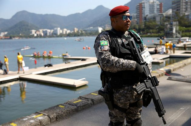 A security guard stands by the Lagoa rowing
