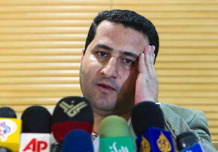 Iranian scientist Shahram Amiri speaks to journalists as he arrives at the Imam Khomini Airport in Tehran, July 15, 2010.