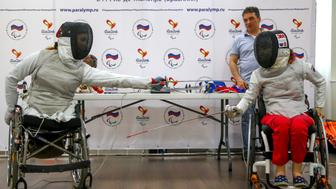 MOSCOW, RUSSIA - MAY 30, 2016: Anna Petukhova (L) and Kseniya Ovsyannikov, members of the Russian wheelchair fencing team, at a press conference on the 2016 Summer Paralympic Games. Vladimir Gerdo/TASS (Photo by Vladimir Gerdo\TASS via Getty Images)