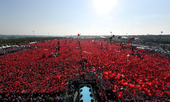 People hold Turkish flags as they take part in Democracy and Martyrs' Rally, held to protest against the July 15 failed coup,