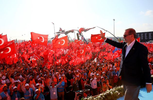 Turkish President Recep Tayyip Erdogan greets people as they gather during Democracy and Martyrs'