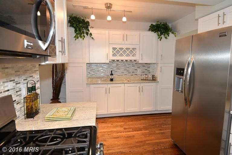 Same kitchen as above, opposite wall space made into additional cabinet and storage space.