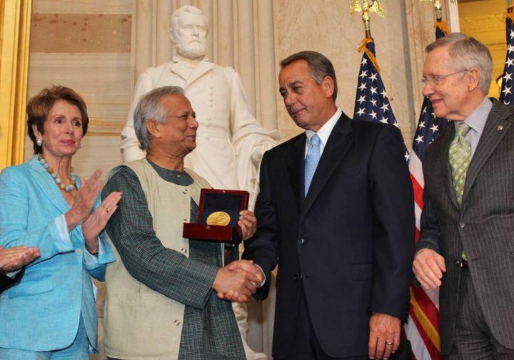 House and Senate leaders (Speaker John Boehner, Nancy Pelosi & Harry Reid) presented Yunus with a Congressional Gold Meda