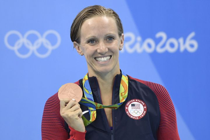 Dana Vollmer poses on the podium after she won bronze in the Women's 100m Butterfly Final during the swimming event at the Ri