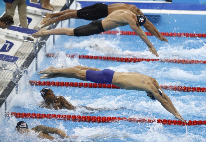Michael Phelps, shown on the second leg of Team USA's victorious 4X100 meter relay, receives cupping treatments.