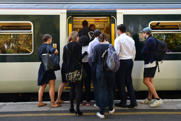 People line up to board a Southern rail service train at East
