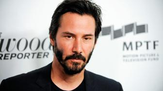 Actor Keanu Reeves arrives at the 2nd Annual Reel Stories, Real Lives event benefiting the Motion Picture & Television Fund in Los Angeles, California October 20, 2012. REUTERS/Gus Ruelas (UNITED STATES - Tags: ENTERTAINMENT)