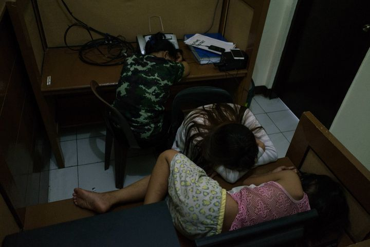 Filipino women take a rest after being arrested at a buy-bust operation at a police station on Sunday, August 72016, in