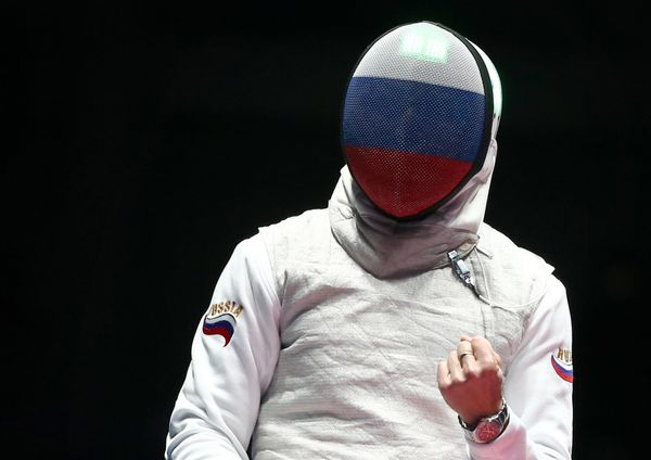 Russia's Timur Safin competes against Britain's Richard Kruse in their men's foil individual fencing bronze medal fight at th