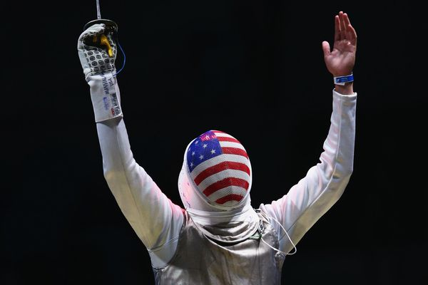 Alexander Massialas of the United States celebrates defeating Giorgio Avola of Italy during the men's individual foil on Day