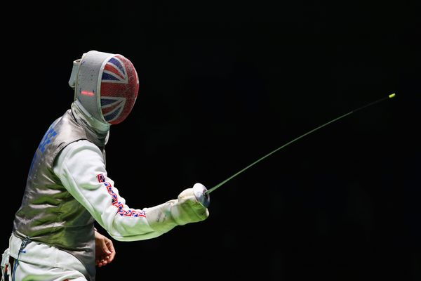 Richard Kruse of Great Britain on his way to defeating Gerek Meinhardt of the United States during the men's individual foil