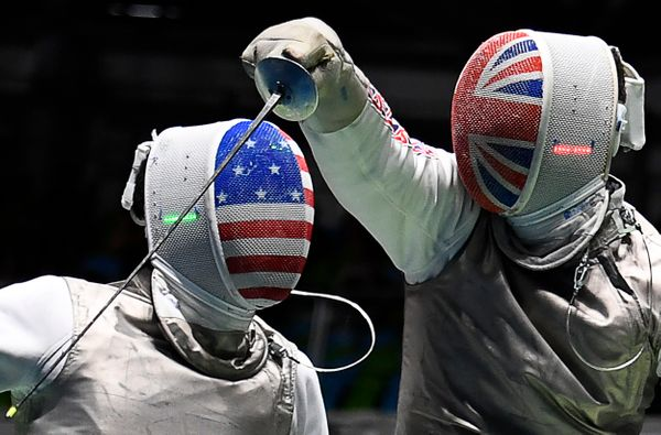 The U.S.'s Gerek Meinhardt (L) competes against Great Britain's Richard Kruse during their men's individual foil quarterfinal