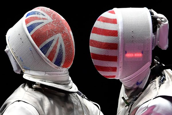 Great Britain's Richard Kruse (L) competes against the U.S.'s Alexander Massialas during their men's individual foil semi-fin