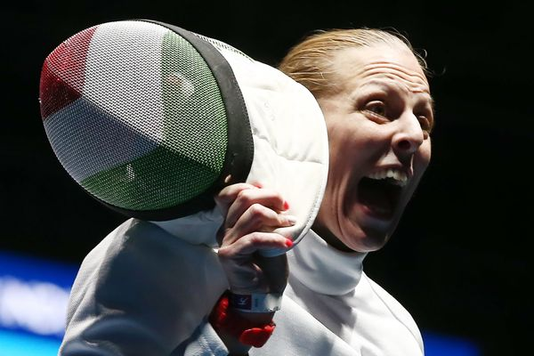 Epee fencer Emese Szasz of Hungary reacts after winning the women's epee individual fencing semifinal against Lauren Rembi of