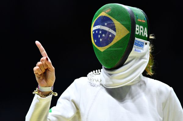 Brazil's Nathalie Moellhausen reacts before her women's individual epee quarterfinal bout against France's Lauren Rembi as pa
