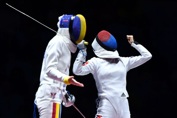 South Korea's Choi Injeong (R) celebrates next to Romania's Ana Maria Popescu during their women's individual epee qualifying