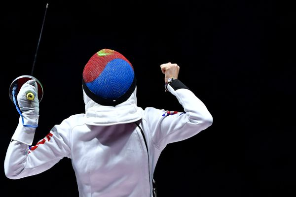 South Korea's Choi Injeong celebrates during her women's individual epee qualifying bout against Romania's Ana Maria Popescu