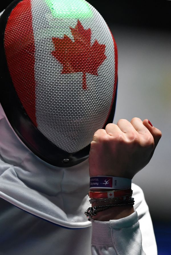 Canada's Leonora Mackinnon reacts as she competes against Romania's Simona Pop during their women's individual epee qualifyin